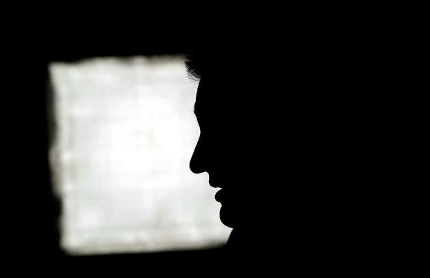 Republican candidate for U.S. Senate Ted Cruz is silhouetted by the camera lights as he conducts an interview with a television reporter Tuesday, Nov. 6, 2012, in Houston. Cruz is running against Democrat Paul Sadler to replace retiring U.S. Sen. Kay Bailey Hutchison. (AP Photo/David J. Phillip) Photo: David J. Phillip, Associated Press / AP
