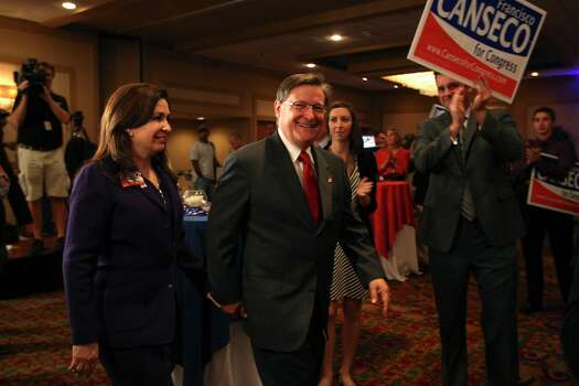 """U.S. Rep. Francisco """"Quico"""" Canseco and his wife, Gloria, arrive at a campaign rally at the Holiday Inn Airport on Election Night, Tuesday, Nov. 6, 2012. Canseco didn't concede the race and said it was too early to call it. Canseco then headed up to a """"war room,""""  to watch the election results. Canseco is in a race with Democrat St. Rep. Pete Gallego, D-Alpine. Photo: Jerry Lara, San Antonio Express-News / © 2012 San Antonio Express-News"""