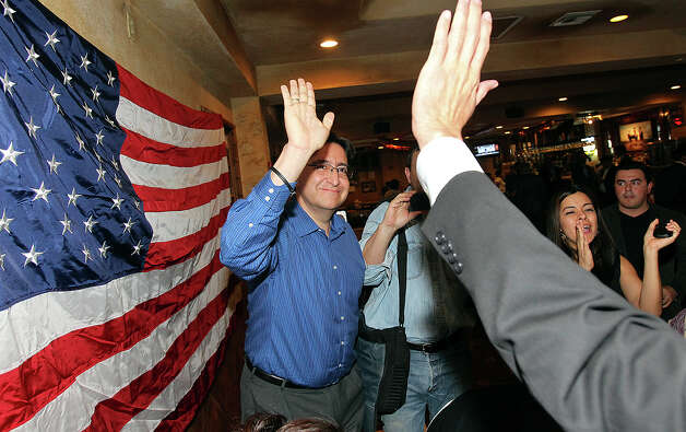 Pete Gallego takes a high five after hearing results that clinched the voctory at the election night watch party for State Representative Pete Gallego, D-Alpine, who is challenging U.S. Representative Francisco Canseco for his seat in the U.S. House District 23  on November 6, 2012. Photo: Tom Reel, San Antonio Express-News / ©2012 San Antono Express-News