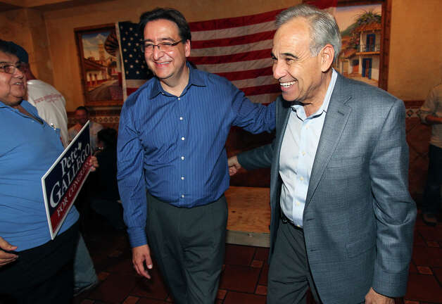 Charlie Gonzalez congratulates Pete Gallego at the election night watch party for State Representative Pete Gallego, D-Alpine, who is challenging U.S. Representative Francisco Canseco for his seat in the U.S. House District 23  on November 6, 2012. Photo: Tom Reel, San Antonio Express-News / ©2012 San Antono Express-News
