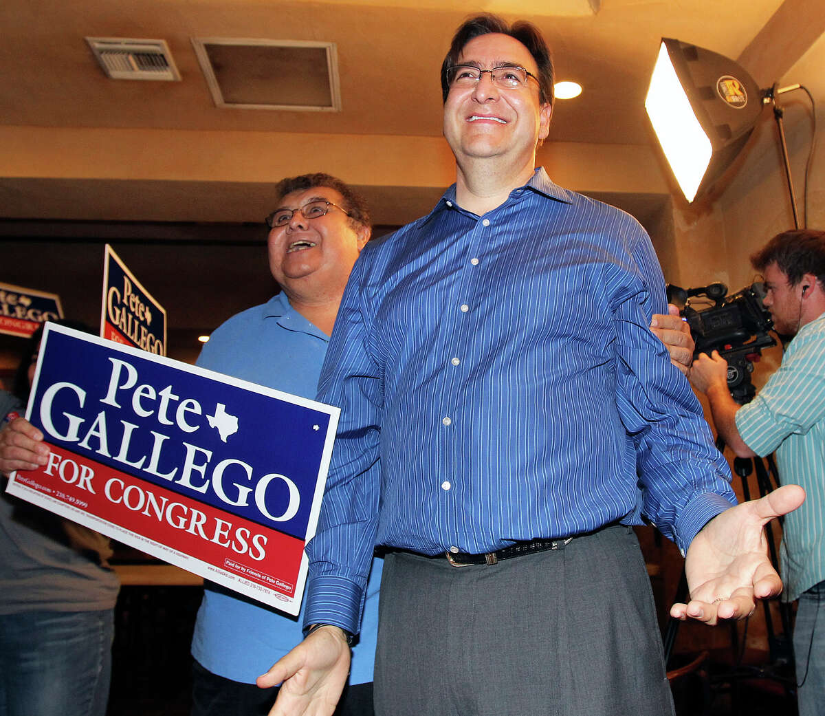 Pete Gallego reacts to a televised report of a large lead larte in the night during the election night watch party for State Representative Pete Gallego, D-Alpine, who is challenging U.S. Representative Francisco Canseco for his seat in the U.S. House District 23 on November 6, 2012.