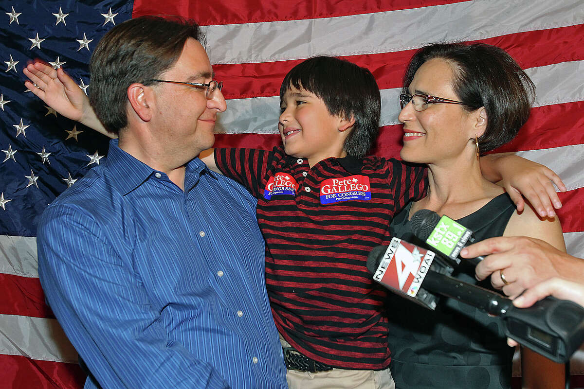 Pete Gallego gets a pat on the back from his son Nicolas as wife Elena listens to his victory speech at the election night watch party for State Representative Pete Gallego, D-Alpine, who is challenging U.S. Representative Francisco Canseco for his seat in the U.S. House District 23 on November 6, 2012.