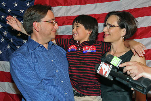 Pete Gallego gets a pat on the back from his son Nicolas as wife Elena listens to his victory speech at the election night watch party for State Representative Pete Gallego, D-Alpine, who is challenging U.S. Representative Francisco Canseco for his seat in the U.S. House District 23  on November 6, 2012. Photo: Tom Reel, San Antonio Express-News / ©2012 San Antono Express-News
