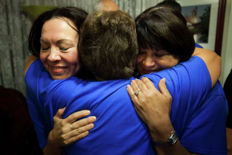 Ali Templer, left, daughter of Senator Mario Gallegos, Connie Sanchez and Theresa Gallegos, wife of Senator Gallegos, embrace after positive election results come in at a watch party for Senator Mario Gallegos, Nov. 6, 2012 in Houston, TX. Gallegos, who passed away in October, is still on the November ballot. He must win in order to keep his seat in Democratic hands and allow the residents of Senate District 6 to elect his replacement. Photo: Eric Kayne, For The Chronicle / 2012 Eric Kayne