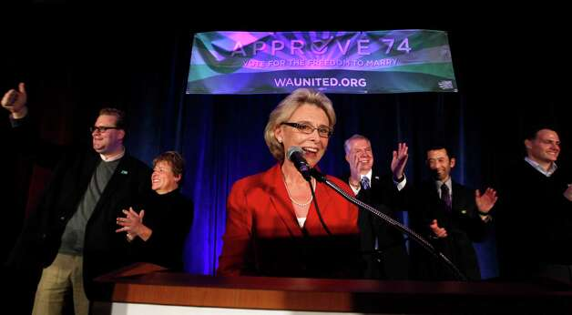 Gov. Chris Gregoire, center, speaks as other elected officials stand behind at an election watch party for proponents of Referendum 74, which would uphold the state's new same-sex marriage law, Tuesday, Nov. 6, 2012, in Seattle. Photo: AP