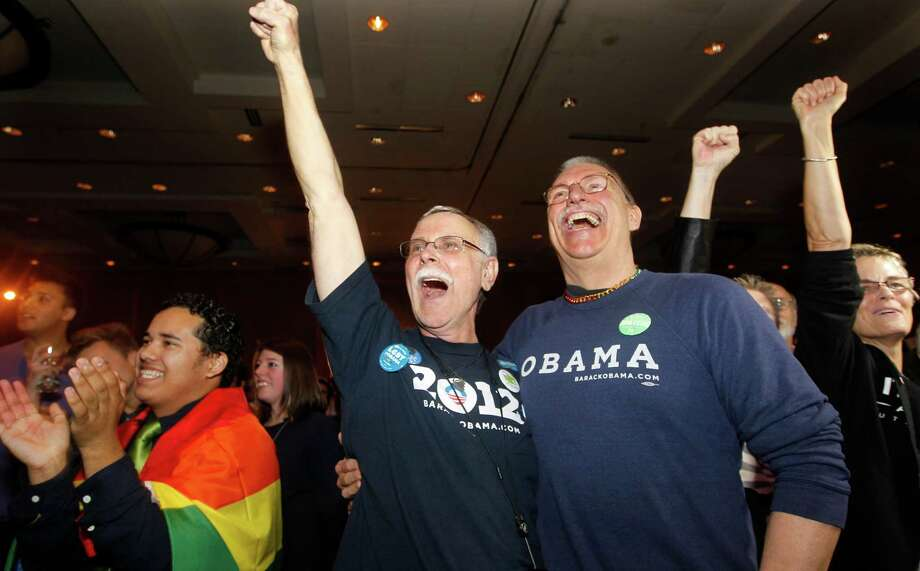Rick Sturgiol, right, and his partner of 34 years Jim Malatak cheer at an election watch party for proponents of Referendum 74, which would uphold the state's new same-sex marriage law, Tuesday, Nov. 6, 2012, in Seattle. Photo: AP