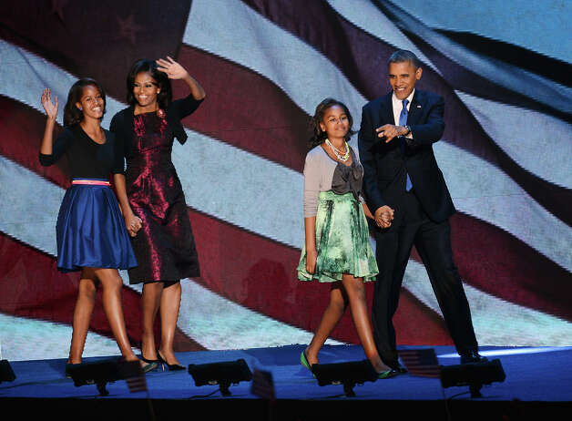US President Barack Obama and family arrive on stage after winning the 2012 US presidential election November 7, 2012 in Chicago, Illinois.  Obama swept to re-election, forging history again by defying the dragging economic recovery and high unemployment which haunted his first term to beat Republican Mitt Romney.   AFP PHOTO / Saul LOEB Photo: SAUL LOEB, AFP/Getty Images / 2012 AFP