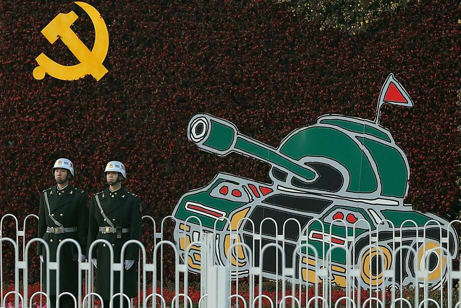 Chinese soldiers stand guard on Chang'an Avenue on November 6, 2012 in Beijing, China. The18th National Congress of the Communist Party of China (CPC) is proposed to convene on November 8 in Beijing. Photo: Feng Li, Getty Images