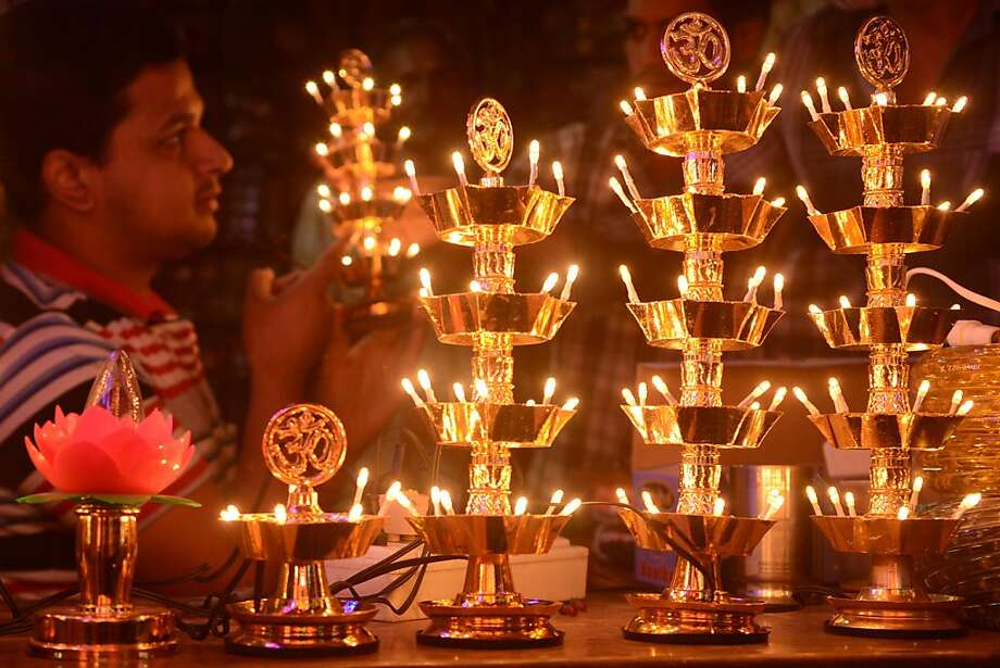 Light decorations are pictured at a shop ahead of Diwali in Amritsar on November 6, 2012. Electric lights and traditional lamps are in heavy demand for the forthcoming Hindu festival of lights, Diwali, which falls on November 13 this year marking the victory over evil and commemorating the time when the Hindu god Lord Rama achieved victory over Ravana and returned to his kingdom Ayodhya. Photo: Narinder Nanu, AFP/Getty Images