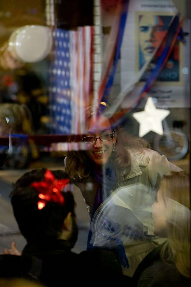Guests are seen through a window as they attend a reception organized by the Italian Democrats Abroad committee to follow the results of the 2012 U.S. Presidential election, in Rome, Wednesday, Nov. 7, 2012. Photo: Andrew Medichini, Associated Press