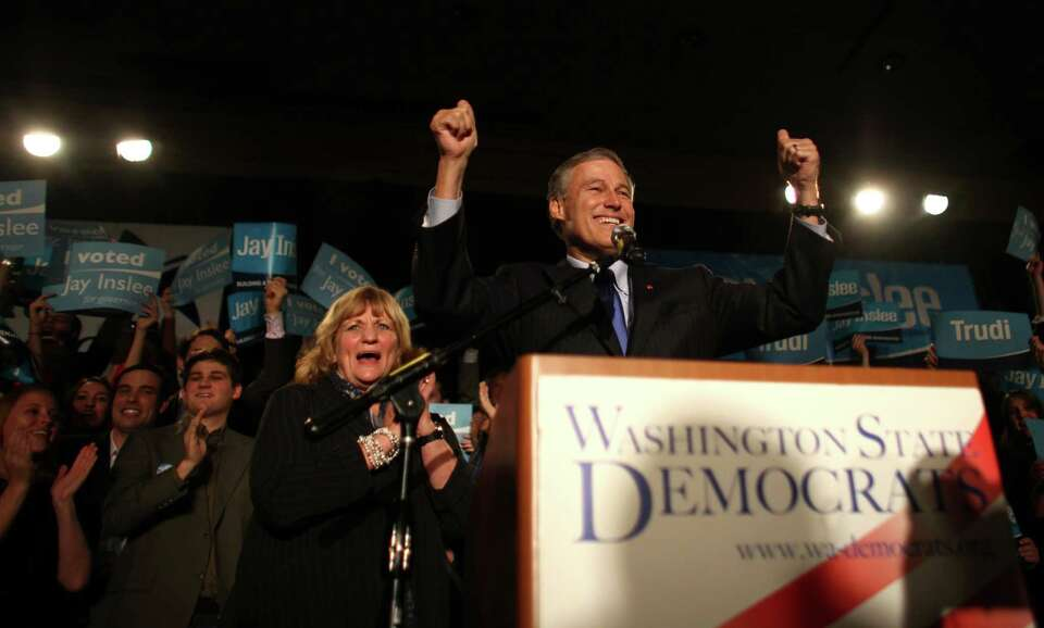 Jay Inslee takes the stage during an election return party for the Washington State Democrats at the