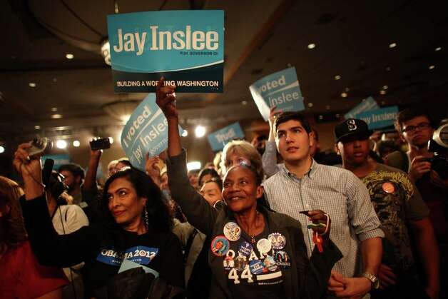 People cheer as Jay Inslee takes the stage during an election return party for the Washington State Democrats at the Westin Hotel on Election Day, Tuesday, November 6, 2012. Photo: JOSHUA TRUJILLO / SEATTLEPI.COM