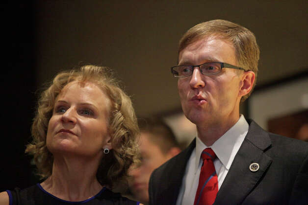 Rob McKenna, right, and wife Marilyn take in the latest election results in the company of family and friends during the Washington State Republican Party's 2012 Election Night Party Nov. 6, 2012 at the Bellevue Hyatt in Bellevue, Wash. (Photo by Cliff DesPeaux for seattlepi.com) Photo: CLIFF DESPEAUX, / / FOR SEATTLEPI.COM
