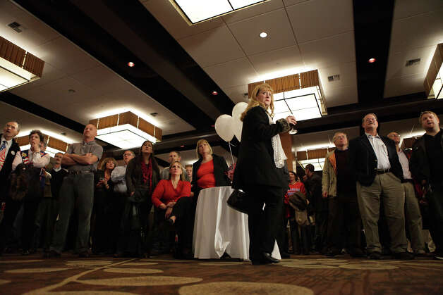 Supporters wait for election results during the Washington State Republican Party's 2012 Election Night Party Nov. 6, 2012 at the Bellevue Hyatt in Bellevue, Wash. (Photo by Cliff DesPeaux for seattlepi.com) Photo: CLIFF DESPEAUX, / / FOR SEATTLEPI.COM