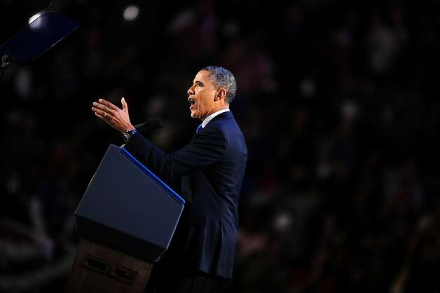 US President Barack Obama addresses suporters after winning the 2012 US presidential lection night November 7, 2012 in Chicago, Illinois.  Obama swept to a emphatic re-election win over Mitt Romney,  forging new history by transcending a dragging economy and the stifling unemployment which haunted his first term.   AFP PHOTO / Robyn BeckROBYN BECK/AFP/Getty Images Photo: Robyn Beck, AFP/Getty Images