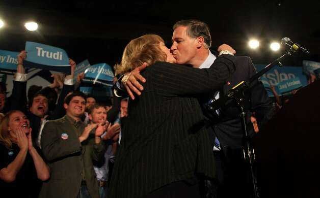 Jay Inslee kisses his wife Trudi Inslee on stage during a Washington State Democrats election return party at the Westin Hotel on Election Day, Tuesday, November 6, 2012. Photo: JOSHUA TRUJILLO / SEATTLEPI.COM