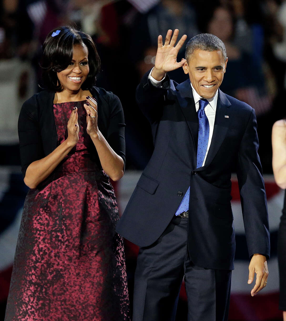 President Barack Obama and first lady Michelle Obama wave at his election night party Wednesday, Nov. 7, 2012, in Chicago. President Obama defeated Republican challenger former Massachusetts Gov. Mitt Romney.
