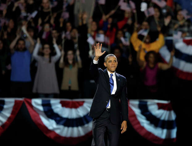President Barack Obama waves at his election night party Wednesday, Nov. 7, 2012, in Chicago. President Obama defeated Republican challenger former Massachusetts Gov. Mitt Romney. Photo: AP