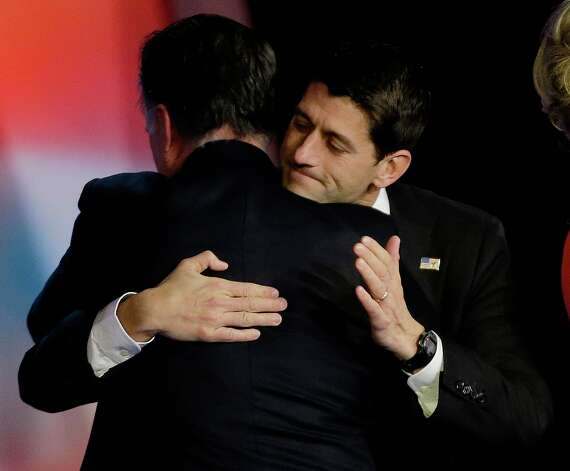 Republican presidential candidate and former Massachusetts Gov. Mitt Romney embraces Republican vice presidential candidate, Rep. Paul Ryan, R-Wis., after Romney conceded the race during his election night rally, Wednesday, Nov. 7, 2012, in Boston. (AP Photo/David Goldman) Photo: David Goldman, Associated Press / AP