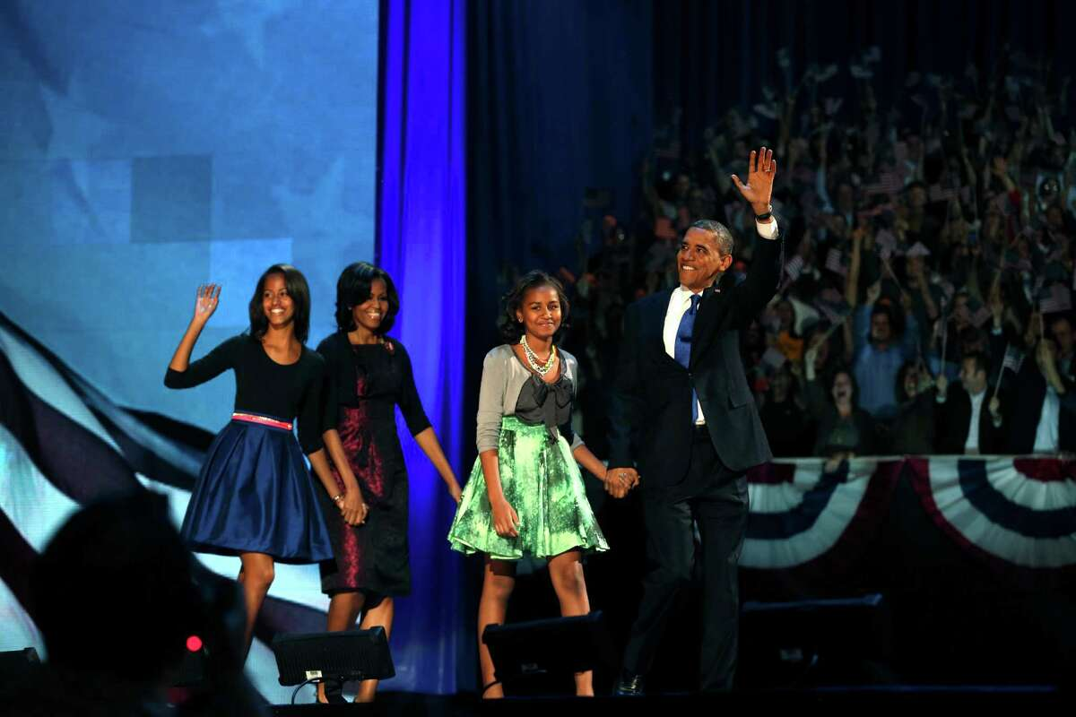 President Barack Obama with his family onstage during his election night event at the McCormick Place Lakeside Center in Chicago, following Election Day, early Wednesday morning, Nov. 7, 2012. Obama has been elected to a second term. From left: Malia Obama, Michelle Obama, Sasha Obama and Barack Obama. (Doug Mills/The New York Times)
