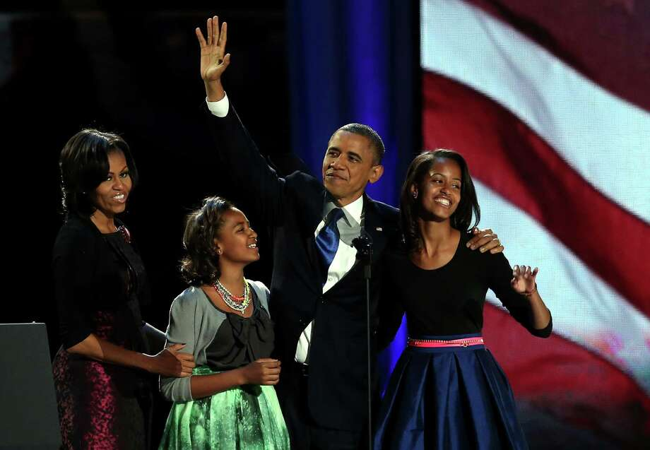 CHICAGO, IL - NOVEMBER 06:  U.S. President Barack Obama walks on stage with first lady Michelle Obama and daughters Sasha and Malia to deliver his victory speech on election night at McCormick Place November 6, 2012 in Chicago, Illinois. Obama won reelection against Republican candidate, former Massachusetts Governor Mitt Romney.  (Photo by Win McNamee/Getty Images) Photo: Win McNamee, Staff / 2012 Getty Images