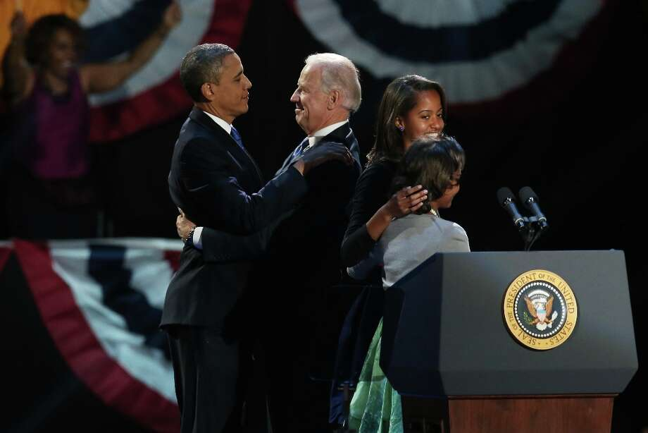CHICAGO, IL - NOVEMBER 06:  U.S. President Barack Obama and U.S. Vice President Joe Biden embrace on stage with family after his victory speech on election night at McCormick Place November 6, 2012 in Chicago, Illinois. Obama won reelection against Republican candidate, former Massachusetts Governor Mitt Romney.  (Photo by Win McNamee/Getty Images) Photo: Win McNamee, Getty Images / 2012 Getty Images