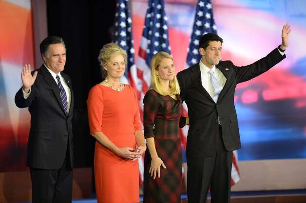 US Republican presidential candidate Mitt Romney (L), his wife Ann (2nd L), running mate Paul Ryan (R) and his wife Janna wave after Romney conceded defeat to President Barack Obama on November 7, 2012 in Boston. Obama swept to re-election, forging history again by transcending a slow economic recovery and the high unemployment which haunted his first term to beat Republican Mitt Romney.     AFP PHOTO/Don EMMERTDON EMMERT/AFP/Getty Images Photo: DON EMMERT, AFP/Getty Images / AFP