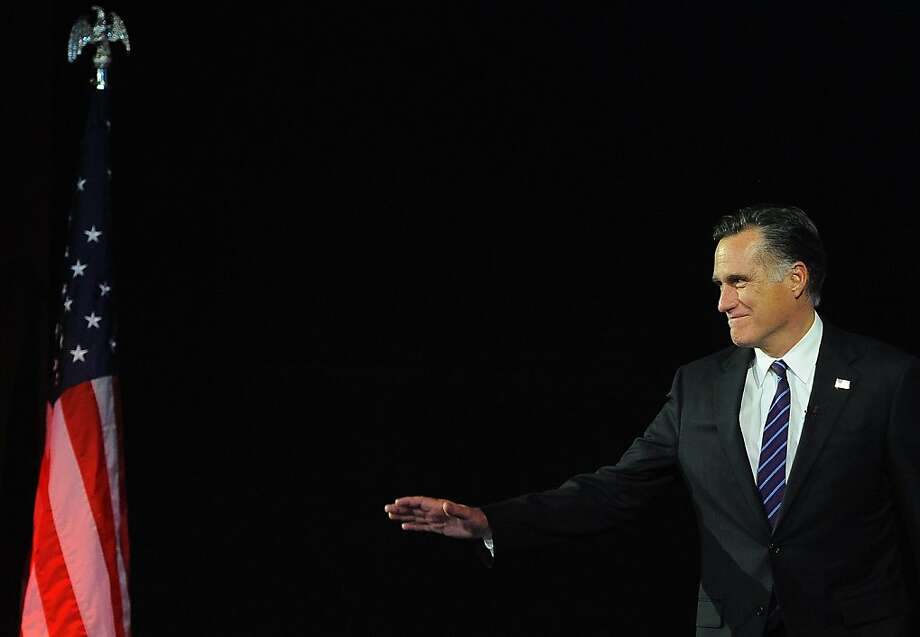 Republican presidential candidate Mitt Romney arrives on stage on election night November 7, 2012 in Boston, Massachusetts, moments before conceding defeat to US President Barack Obama in the 2012 US presidential election.     AFP PHOTO/EMMANUEL DUNANDEMMANUEL DUNAND/AFP/Getty Images Photo: Emmanuel Dunand, AFP/Getty Images