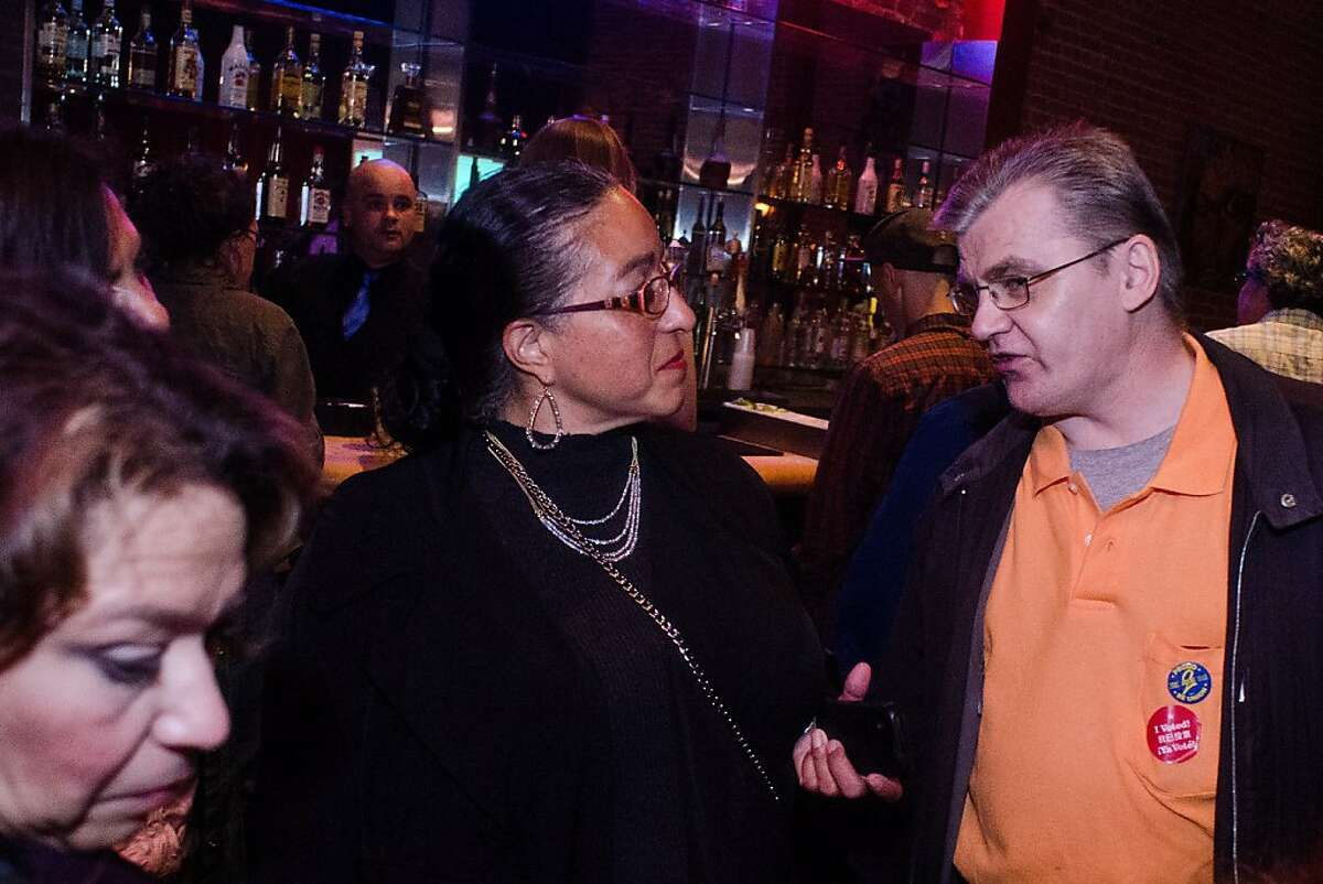 District 5 Supervisor Christina Olague speaks with long-time friend David Harlan, right, during her election night party at Rasselas Jazz Club in San Francisco, California on November 6, 2012.