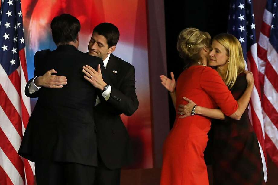 BOSTON, MA - NOVEMBER 07: (L-R) Republican presidential candidate, Mitt Romney, hugs Republican vice presidential candidate, U.S. Rep. Paul Ryan (R-WI) while his wife, Ann Romney, hugs Janna Ryan after conceding the presidency during Mitt Romney's campaign election night event at the Boston Convention & Exhibition Center on November 7, 2012 in Boston, Massachusetts. After voters went to the polls in the heavily contested presidential race, networks projected incumbent U.S. President Barack Obama has won re-election against Republican candidate, former Massachusetts Gov. Mitt Romney.  (Photo by Alex Wong/Getty Images) Photo: Alex Wong, Getty Images