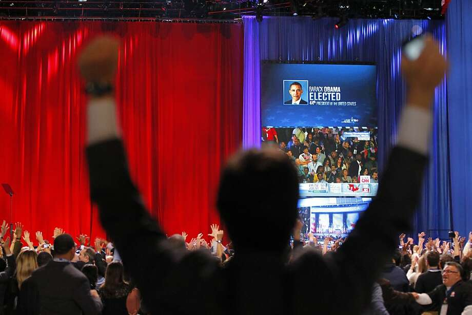 A supporter of President Barack Obama raises his arms as it is announced that Obama was re-elected during an election night watch party in Chicago early Wednesday, Nov. 7 2012. (AP Photo/Jerome Delay) Photo: Jerome Delay, Associated Press