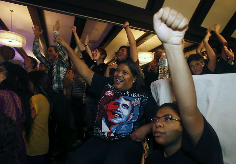 Meta Hutchison, center, and her daughter Jade Frost, right, cheer during a broadcast of President Barack Obama's victory speech at a night watch party Tuesday, Nov. 6, 2012, in Salt Lake City.  (AP Photo/Jim Urquhart) Photo: Jim Urquhart, Associated Press