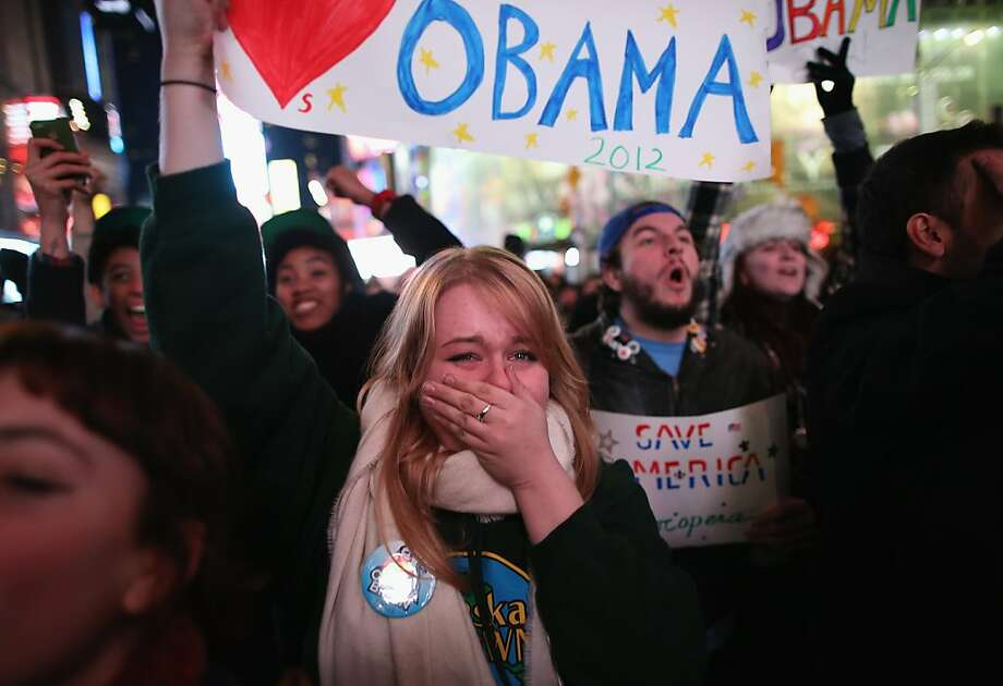 NEW YORK, NY - NOVEMBER 06:   Jessica Clark, 18, reacts in Times Square as television networks call the election in favor of President Barack Obama on November 6, 2012 in New York City. She said she voted for the first time in Tuesday's election.   According to network projections incumbent U.S. President Barack Obama has won a second term.  (Photo by John Moore/Getty Images) Photo: John Moore, Getty Images