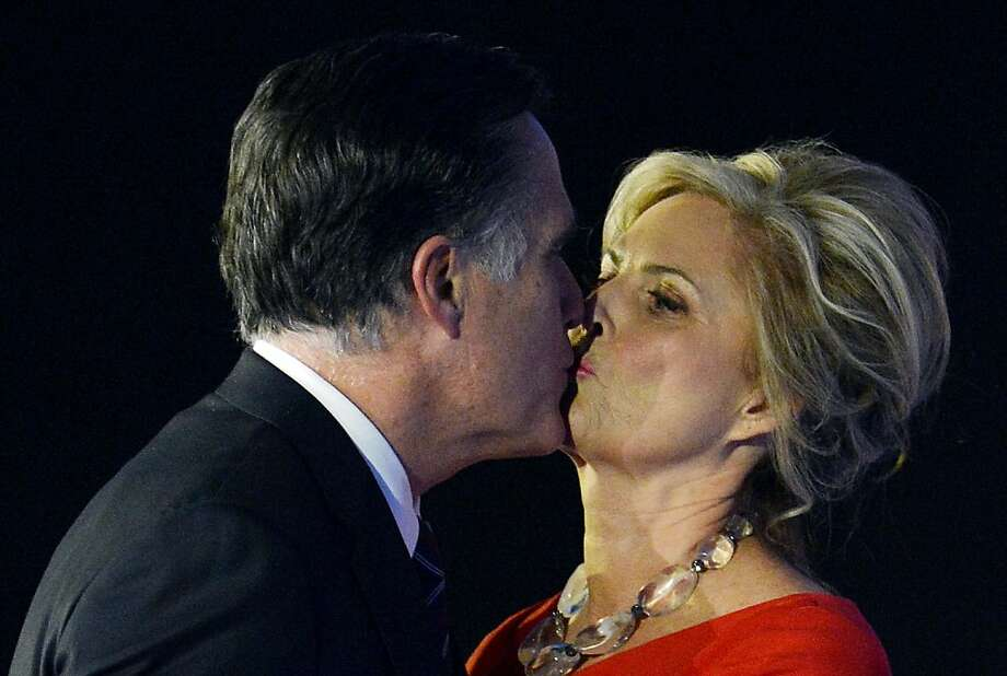 US Republican presidential candidate Mitt Romney kisses his wife Ann after conceding defeat to President Barack Obama on November 7, 2012 in Boston. Obama swept to re-election, forging history again by transcending a slow economic recovery and the high unemployment which haunted his first term to beat Romney.    AFP PHOTO/Stan HONDASTAN HONDA/AFP/Getty Images Photo: Stan Honda, AFP/Getty Images