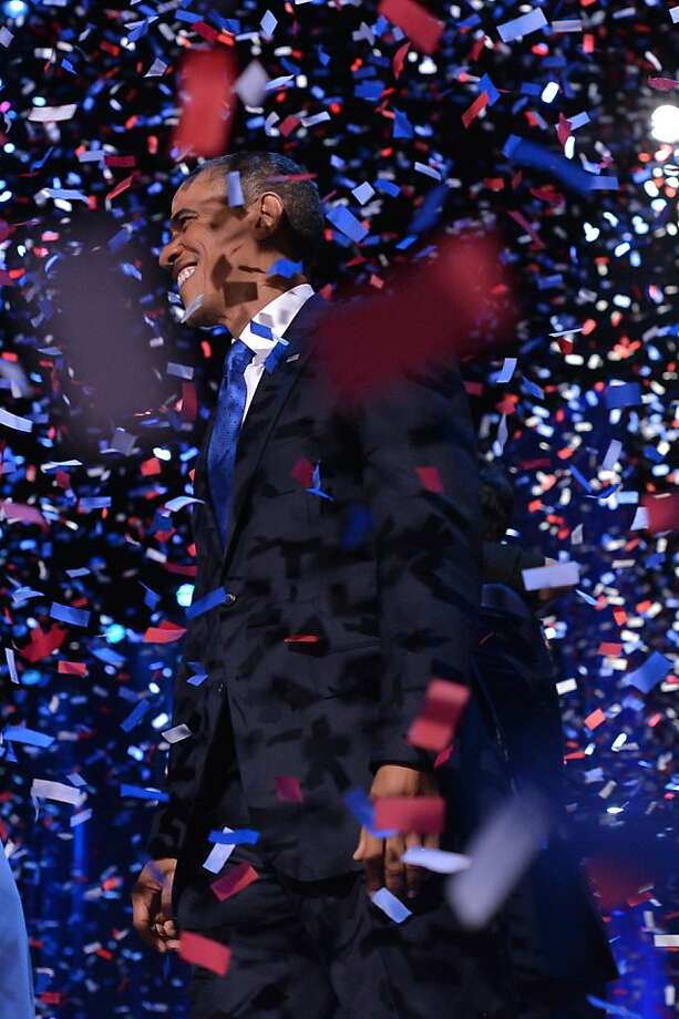 US President Barack Obama celebrates on stage after delivering his acceptance speech ion Chicago on November 7, 2012. Obama swept to re-election, forging history again by transcending a slow economic recovery and the high unemployment which haunted his first term to beat Republican Mitt Romney.     AFP PHOTO/Jewel SAMADJEWEL SAMAD/AFP/Getty Images Photo: Jewel Samad, AFP/Getty Images