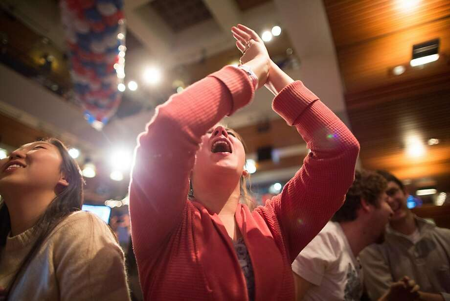 A student reacts as she watches election returns come in inside the Kennedy Forum at the Harvard University John F. Kennedy School of Government in Cambridge, Massachusetts, U.S., on Tuesday, Nov. 6, 2012. Barack Obama, the post-partisan candidate of hope who became the first black U.S. president, won re-election today by overcoming four years of economic discontent with a mix of political populism and electoral math. Photographer: Scott Eisen/Bloomberg Photo: Scott Eisen, Bloomberg