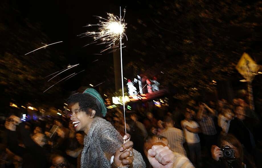Crystal Davis, of Seattle, waves a sparkler as she celebrates the 2012 election with a large crowd in Seattle's Capitol Hill neighborhood, Tuesday, Nov. 6, 2012, in Seattle's Capitol Hill neighborhood. The re-election of President Barack Obama and Washington state's referendum 74, which would legalize gay marriage, drew the most supporters to the streets. (AP Photo/Ted S. Warren) Photo: Ted S. Warren, Associated Press