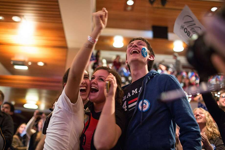 Students supporting U.S. President Barack Obama react as they watch election returns come in inside the Kennedy Forum at the Harvard University John F. Kennedy School of Government in Cambridge, Massachusetts, U.S., on Tuesday, Nov. 6, 2012. Obama, the post-partisan candidate of hope who became the first black U.S. president, won re-election today by overcoming four years of economic discontent with a mix of political populism and electoral math. Photographer: Scott Eisen/Bloomberg Photo: Scott Eisen, Bloomberg