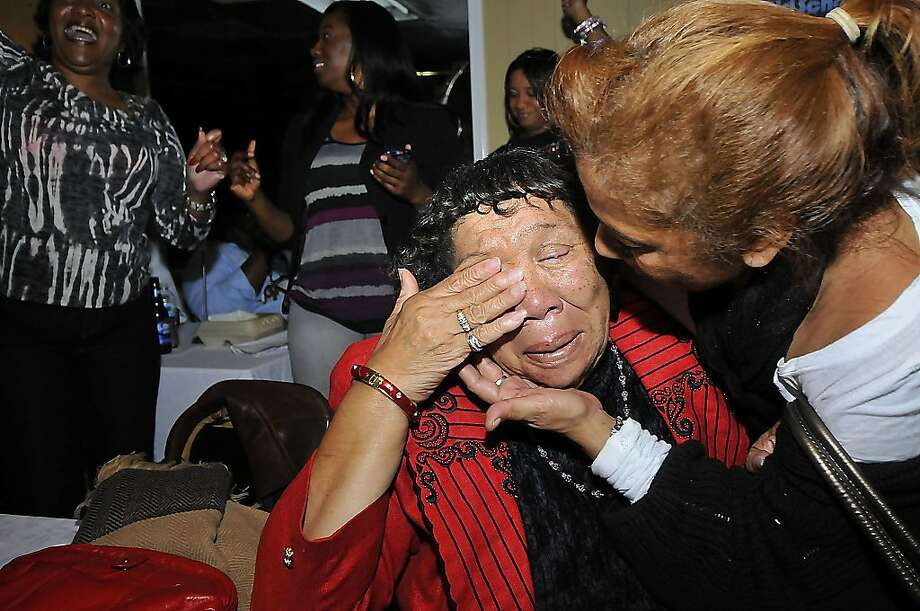 Mamie Moore, 78, of Charlotte, left, is comforted by another supporter as President Barack Obama is elected for a second term following elections, Tuesday, Nov. 6, 2012, in Charlotte, N.C. Obama supporters came out to watch and celebrate the election returns at the Excelsior Club. (AP Photo/The Charlotte Observer, T. Ortega Gaines) Photo: T. Ortega Gaines, Associated Press