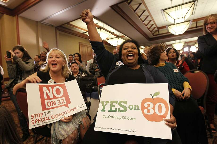 California Teachers Association members Cynthia Menzel (left) and Patricia Rucker rally for Proposition 30 in 2012. Extending some of the temporary educational taxes that voters approved that year is likely to be on the union's agenda in 2016. Photo: Michael Macor, The Chronicle