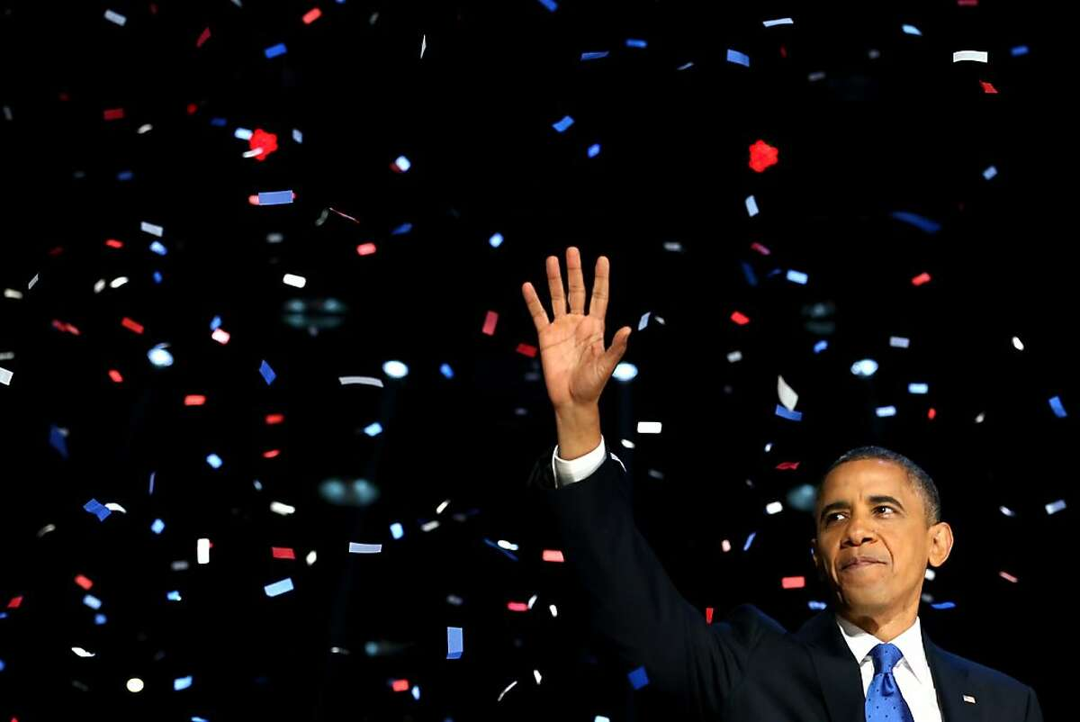 President Barack Obama waves to supporters after his victory speech at McCormick Place on election night November 6, 2012 in Chicago, Illinois. Obama won reelection against Republican candidate, former Massachusetts Governor Mitt Romney.