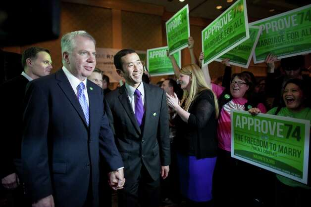 State Senator Ed Murray and his partner Michael Shiosaki prepare to take the stage as people celebrate the initial returns on Referendum 74 during a party at the Westin Hotel on Election Day, Tuesday, November 6, 2012. Photo: JOSHUA TRUJILLO / SEATTLEPI.COM