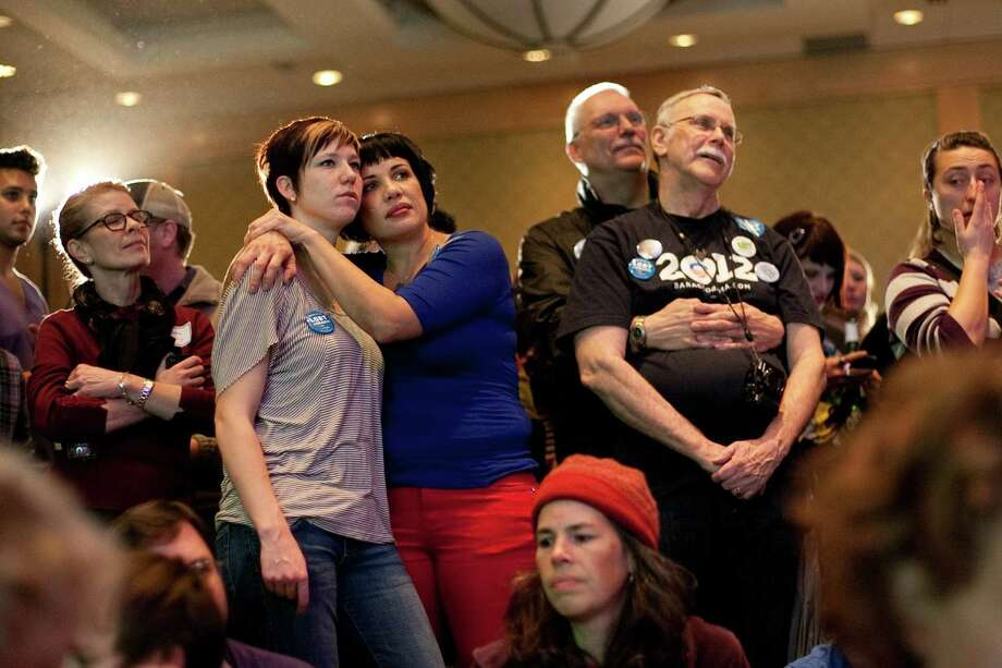 Daphne Draayer, left, and her partner Vanessa J. Williams, in blue, watch election returns along with Rick Sturgill and Jim Malatak, right, during an election return party for Referendum 74 at the Westin Hotel on Election Day, Tuesday, November 6, 2012. Photo: JOSHUA TRUJILLO / SEATTLEPI.COM
