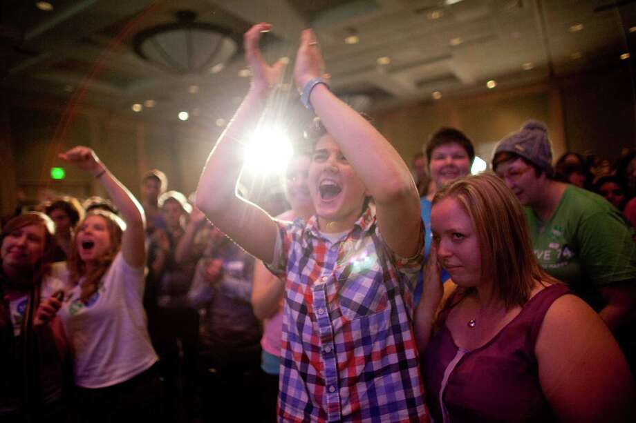 People celebrate the initial returns on Referendum 74 during a party at the Westin Hotel on Election Day, Tuesday, November 6, 2012. Photo: JOSHUA TRUJILLO / SEATTLEPI.COM