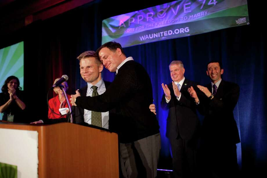 State Representative Jamie Pedersen is embraced by his partner Eric Cochran Pedersen during a speech about Referendum 74 at the Westin on Election Day, Tuesday, November 6, 2012. Photo: JOSHUA TRUJILLO / SEATTLEPI.COM