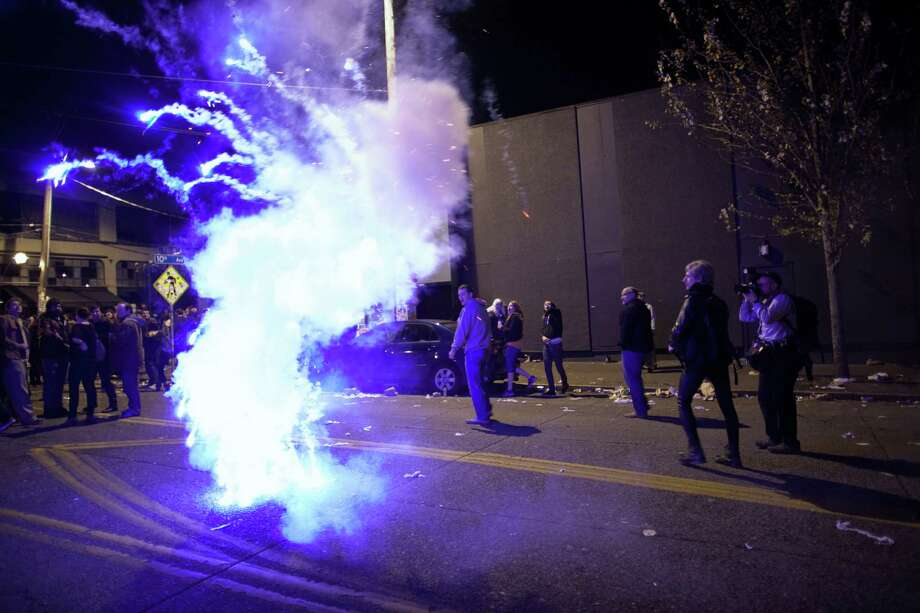 A firework is exploded as a spontaneous party erupts in the intersection of East Pike Street and 10th Avenue after Barack Obama was announced as the winner, Referendum 74 appeared to be passing and a measure to legalize marijuana also seemed to be passing on Election Day, Tuesday, November 6, 2012. Photo: JOSHUA TRUJILLO / SEATTLEPI.COM