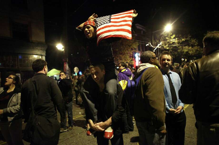 People have fun as a spontaneous party erupts in the intersection of East Pike Street and 10th Avenue after Barack Obama was announced as the winner, Referendum 74 appeared to be passing and a measure to legalize marijuana also seemed to be passing on Election Day, Tuesday, November 6, 2012. Photo: JOSHUA TRUJILLO / SEATTLEPI.COM