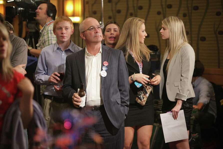 Supporters wait for election results during the Washington State Republican Party's 2012 Election Ni