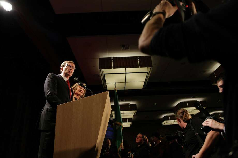 Rob McKenna, alongside wife Marilyn, speaks to supporters before the early election results come in during the Washington State Republican Party's 2012 Election Night Party Nov. 6, 2012 at the Bellevue Hyatt in Bellevue, Wash. Photo: CLIFF DESPEAUX / FOR SEATTLEPI.COM