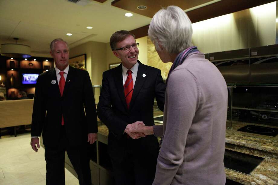 Rob McKenna, center, greets supporters at the VIP reception during the Washington State Republican Party's 2012 Election Night Party Nov. 6, 2012 at the Bellevue Hyatt in Bellevue, Wash. Photo: CLIFF DESPEAUX / FOR SEATTLEPI.COM